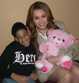 Miley with a fan on the set of So Undercover