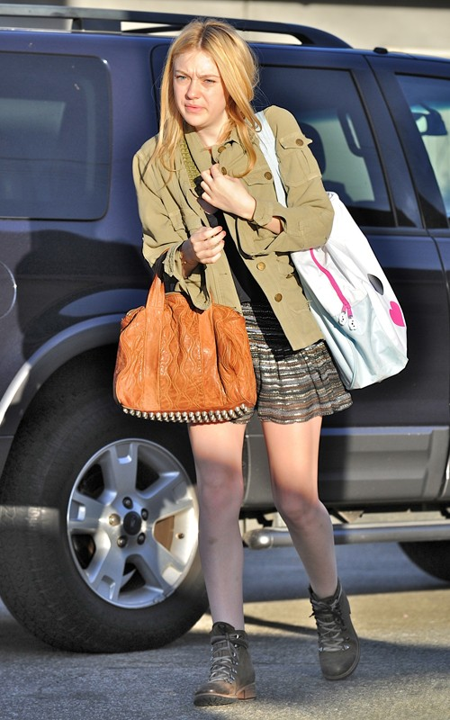 Dakota looking fashionable as she headed to school (photos)