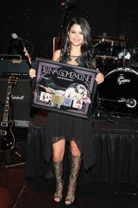Selena receiving her gold record for WTSGD