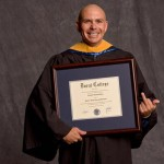 Pitbull Flips His Middle Finger As A Poses For His Graduation Photo