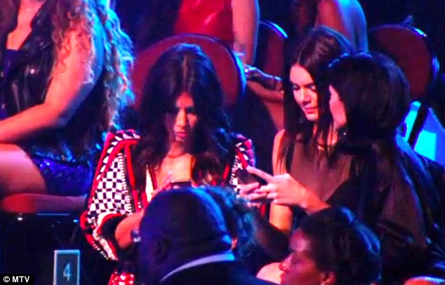 Kardashian Sisters Cause Trouble As They Are Spotted Texting And Chatting At The MTV VMAs Thought The Moment Silence For Michael Brown